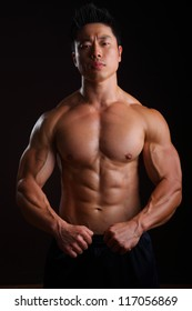 Asian Body Builder front muscles, biceps, abs, pecks