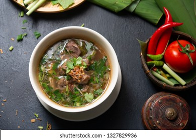 Asian bone soup or sup tulang, popular traditional malay dish. Top view flat lay.