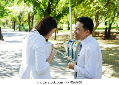 Asian boss is flirting young Asian businesswoman.