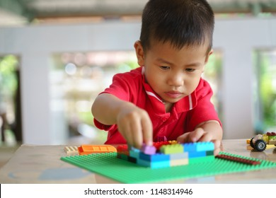 Asian boy about 2 year and 5 months is playing building blocks