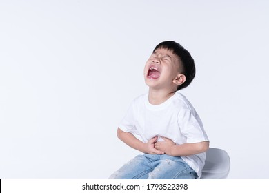 Asian boy about 4 year old touching his belly from stomach pain symptom