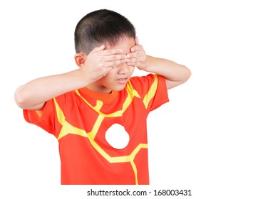 Asian boy closing eyes with his hands isolated on white background