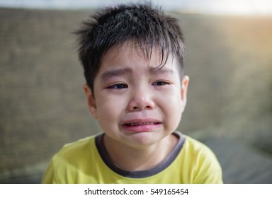The asian boy crying. Chinese boy is sad.
