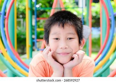 Asian boy enjon with outdoor playground