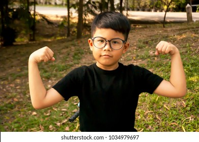 Asian boy feeling strong in the park, ride bicycle, exercise in the morning, healthy lifestyle for good health, fit and firm. Build body grown up to smart and handsome man, Kid model for healthy life.