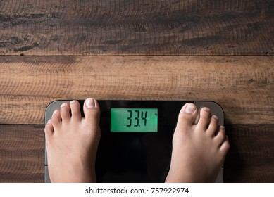 asian boy feet on a weighing scale - boy standing on weighing scale