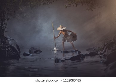 Asian boy fishing in the creek, Thailand countryside