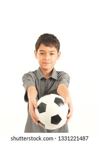 Asian boy with football on white background