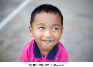 Asian boy fun face expression