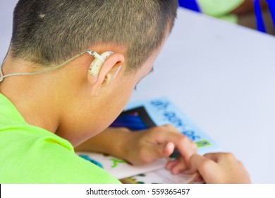 Asian boy have a Hearing Aids.