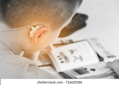Asian boy have a Hearing Aids.(Black and white tone.)