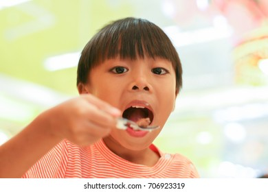 Asian boy in ice cream shop