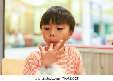 Asian boy in ice cream shop