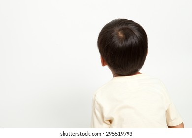 Asian boy kid interest in something like looking or staring at