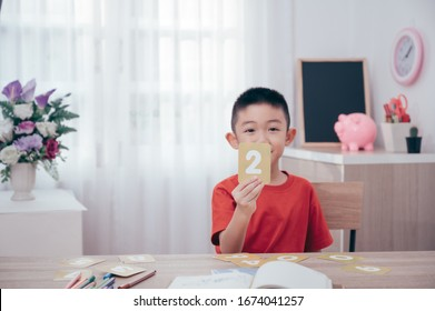 Asian Boy play math number card game at home.Play and learn Education concept