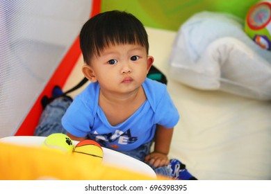 Asian boy playing colorful toy