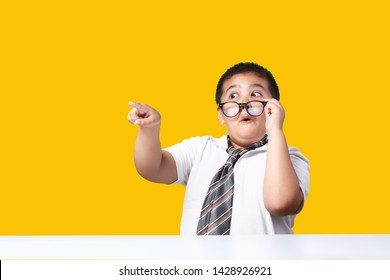 Asian boy pointing and touching for use present. isolated on yellow