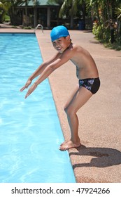 asian boy preparing to dive into the pool
