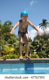asian boy preparing to dive on a swimming pool