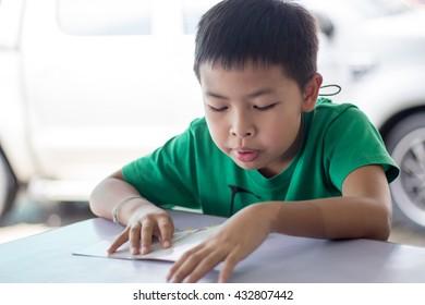 asian boy read the book