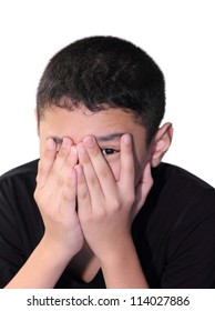 Asian boy scared his hands covering the eye.