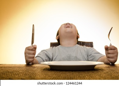 asian boy screaming on dining table waiting for food