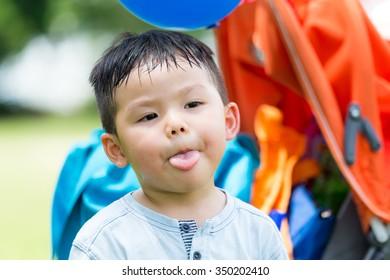 Asian boy show his tongue