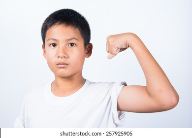asian boy showing his muscles isolated on white background