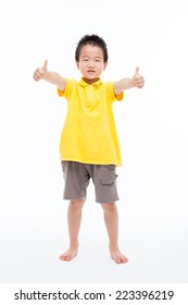 Asian boy shwoing thumb isolated on white background.