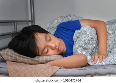 Asian boy sleeping