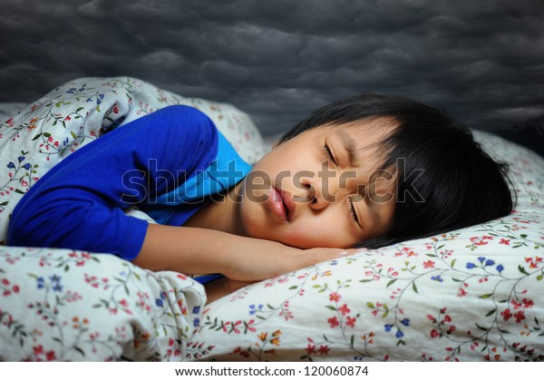 Asian boy with sleeping disorder ( bad dream )