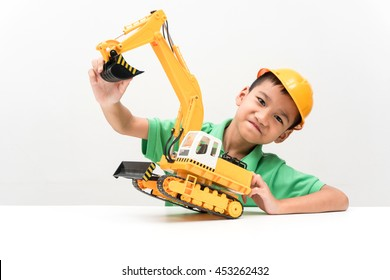 asian boy smile and happy with toy, little engineer building concept.