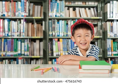 Asian Boy smiling in library room school
