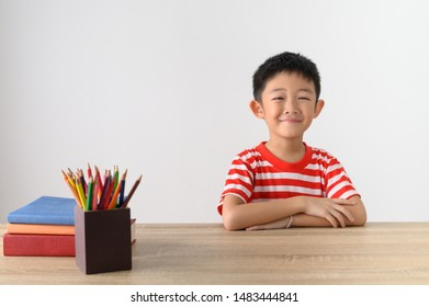 Asian Boy smiling and white wall in  room school.Education Concept