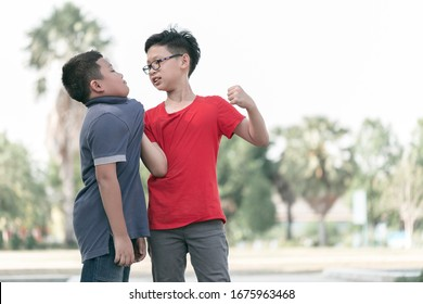 Asian Boy student getting bullied in school. Children bullying their classmate in playground.Violence, Banner and problem of bullying concept