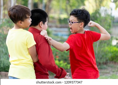 Asian boy student suffering or getting bullied in school or Children fighting or attacked their classmate in school. teenage,education, bullying, violence, aggression and people concept