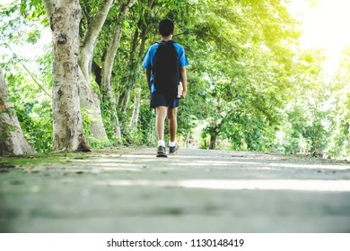 Asian boy student walking on street back to school in the morning