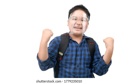 Asian boy student wear face shield excited surprised or make winner gesture isolated on white background. against and  prevent corona virus covid 19 and new normal back to school concept