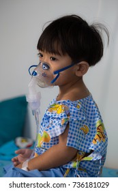 Asian boy suffering from respiratory disease and treated with steam with inhaler.