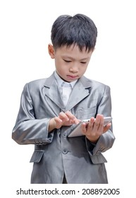 Asian boy in suit using tablet computer on white background