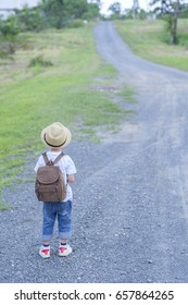 Asian boy walking on the road  outdoors.Travel Vacation Summer Concept