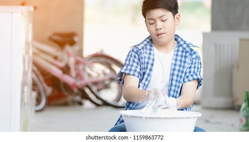 Asian boy washing his towel by hand, Thai little doing housework boy at the home.