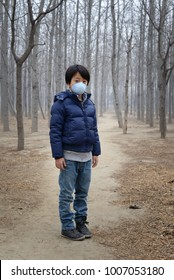Asian boy wearing mask to protect against air pollution