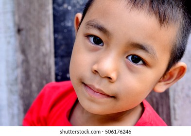 Asian boy wearing Red T-shirt breezy,bright in Morning holidays
