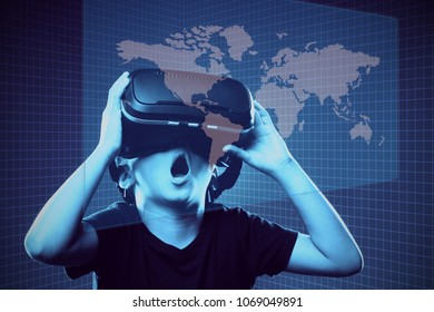 Asian boy wearing virtual reality (VR) googles. Adoption of technology in education.  Futuristic learning experience. Mixed media.