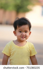 Asian boy in yellow dress and he smiled are happy,concept of children growth by age.