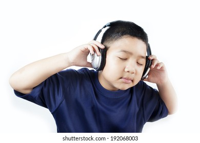 Asian boys are eyes closed listening to music on headphones.