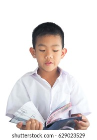 Asian boys wear white chiffon shirts, make a cute gesture and smile sincerely, are reading books with a happy smile.