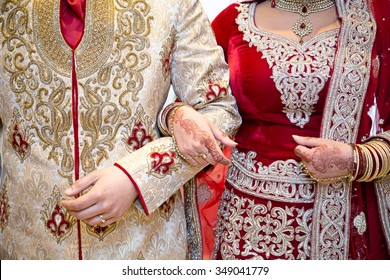 Asian bride and groom arm in arm