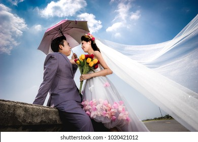 Asian bride and groom to be married on Valentine's Day.